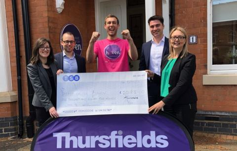 Thursfields holding charity cheque