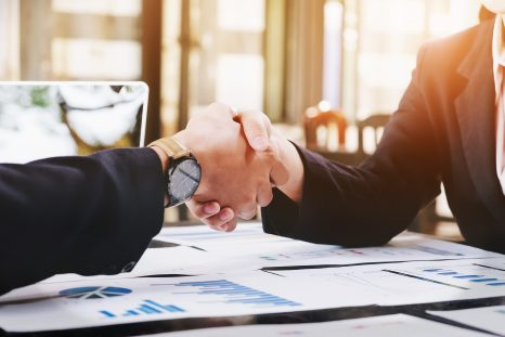 Sealing a deal, Business man and woman handshake to business agreement.