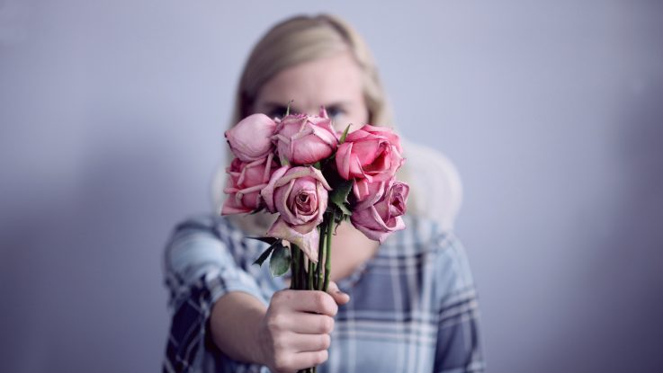 Lady holding a bunch of roses