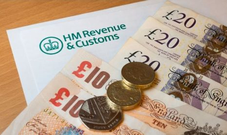 HM Revenue & Customs Letter with money on top